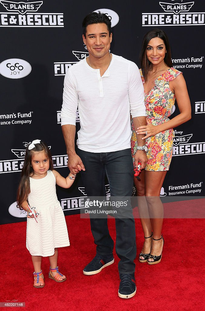 TV personality Mario Lopez (C), daughter Gia Lopez (L) and wife Courtney Mazza (R) attend the premiere of Disney's 'Planes: Fire & Rescue' at the El Capitan Theatre on July 15, 2014 in Hollywood, California.