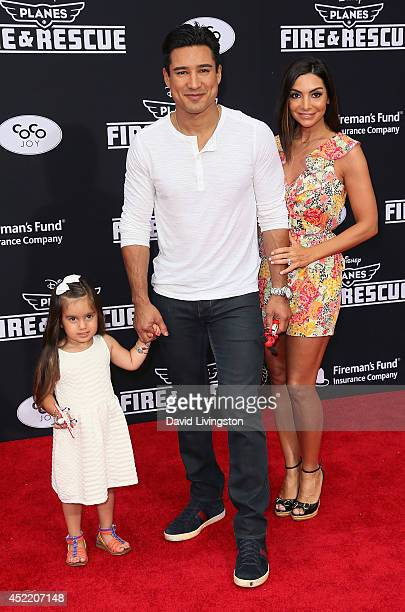 TV personality Mario Lopez daughter Gia Lopez and wife Courtney Mazza attend the premiere of Disney's 'Planes Fire Rescue' at the El Capitan Theatre...