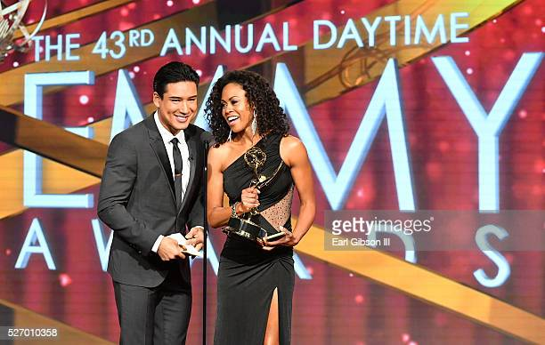 Personality Mario Lopez presents actress Vinessa Antoine her Emmy at 43rd Annual Daytime Emmy Awards at the Westin Bonaventure Hotel on May 1 2016 in...