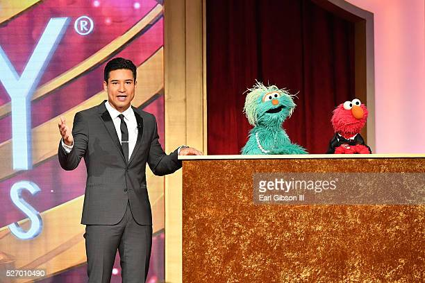 TV personality Mario Lopez with muppets Rosita and Elmo speak onstage at the 43rd Annual Daytime Emmy Awards at the Westin Bonaventure Hotel on May 1...
