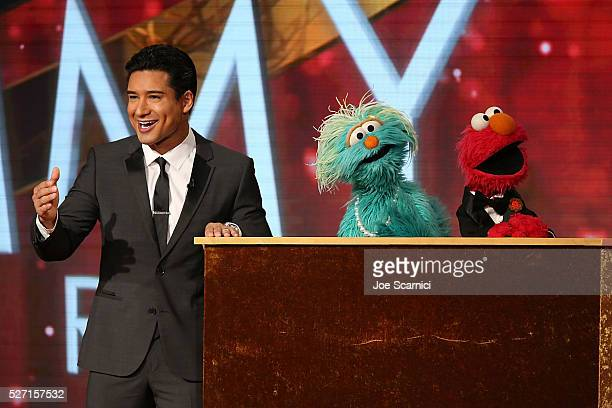 TV personality Mario Lopez with muppets Rosita and Elmo speak onstage at the 43rd Annual Daytime Emmy Awards at the 2016 Daytime Emmy Awards at...