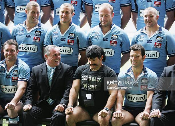 TV personality Matthew Johns as his alter ego Reg Reagan poses with the NRL New South Wales Blues team during the team photo session at the Telstra...