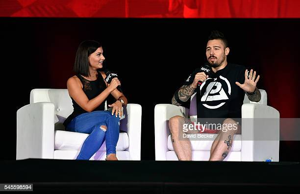 UFC personality Megan Olivi and mixed martial artist Dan Hardy speak on stage at the UFC Fan Expo at the Las Vegas Convention Center on July 8 2016...