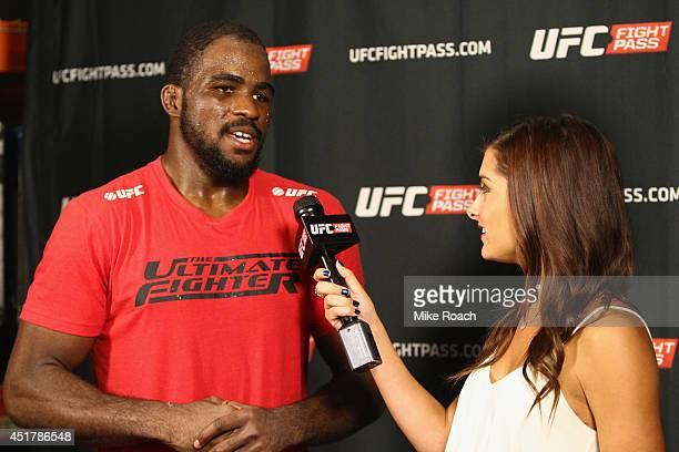UFC personality Megan Olivi interviews The Ultimate Fighter season 19 light heavyweight winner Corey Anderson during the Ultimate Fighter Finale...