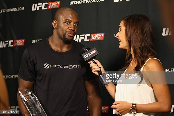 UFC personality Megan Olivi interviews the Ultimate Fighter season 19 middleweight winner Eddie Gordon during the Ultimate Fighter Finale inside the...