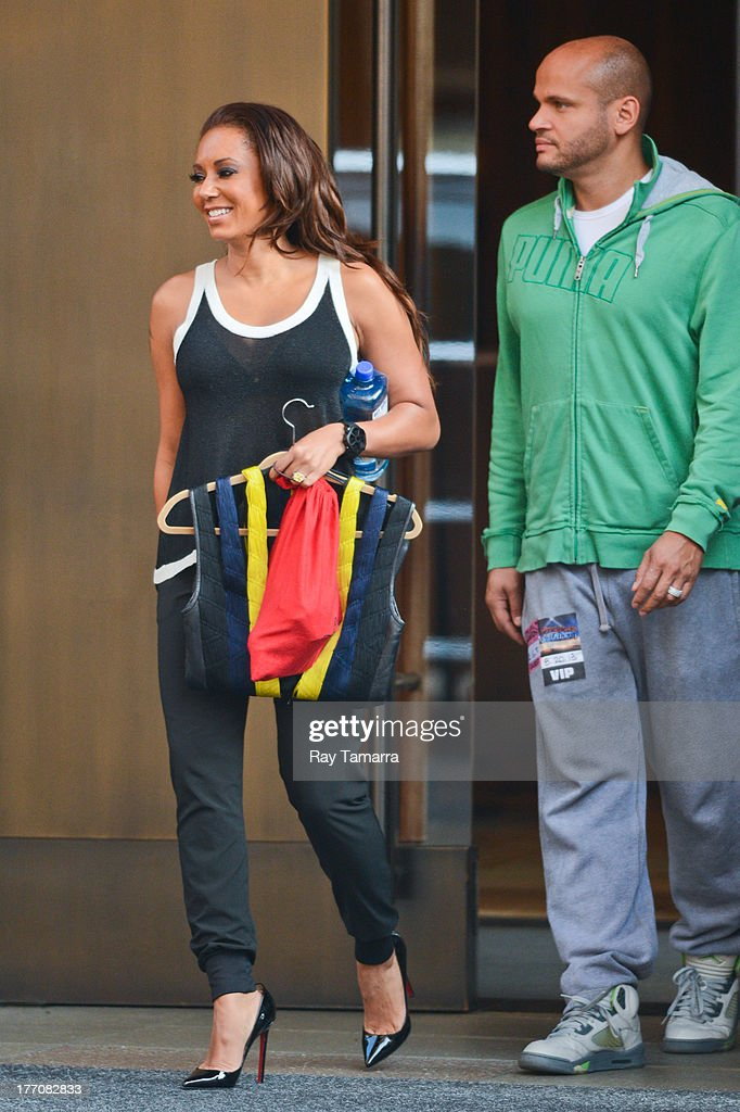 TV personality Melanie Brown (L) and Stephen Belafonte leave their Soho hotel on August 20, 2013 in New York City.