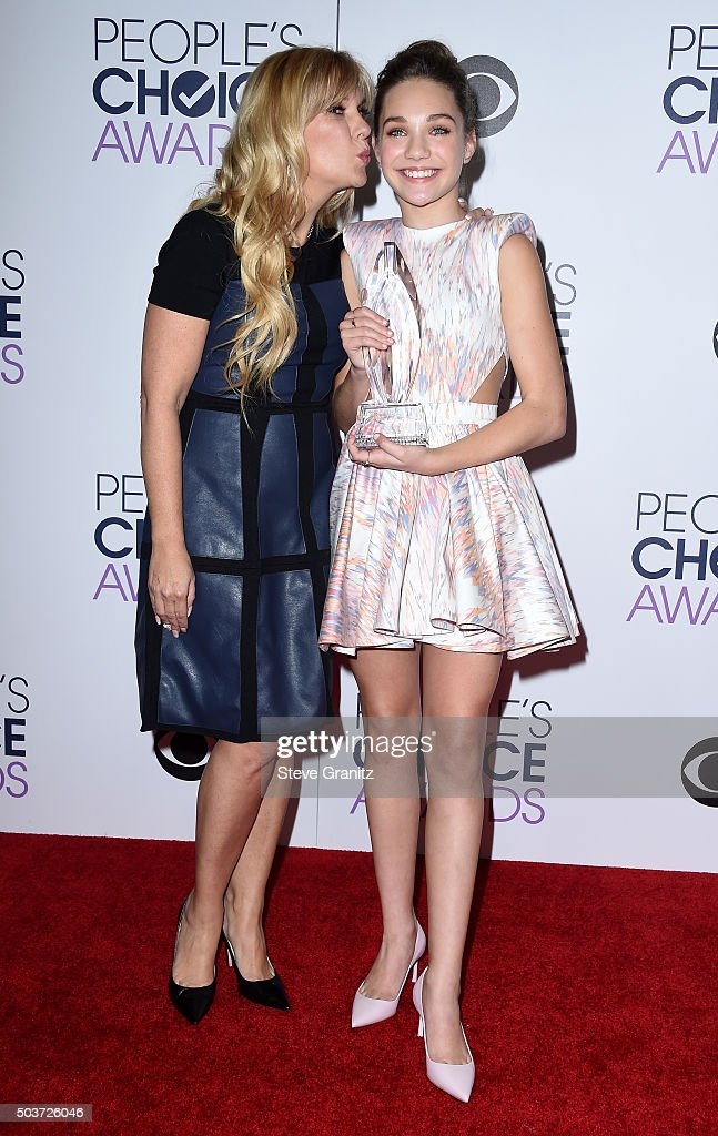 TV personality Melissa Gisoni (L) and TV personality/dancer Maddie Ziegler pose in the press room during the People's Choice Awards 2016 at Microsoft Theater on January 6, 2016 in Los Angeles, California.
