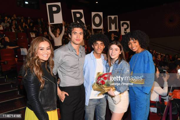 TV Personality Melissa Grelo actor Charles Melton fans and Yara Shahidi pose with fans at the ultimate 'Promposal' at a Toronto screening of 'The Sun...