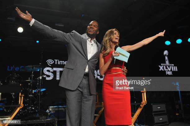 Personality Michael Strahan and FOX Sports broadcaster Erin Andrews speak at Time Warner Cable Studios Presents FOX Sports 1 Thursday Night Super...