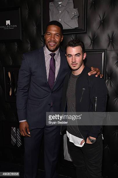 TV personality Michael Strahan and musician Kevin Jonas attend JCPenney and Michael Strahan's launch of Collection by Michael Strahan on September 30...