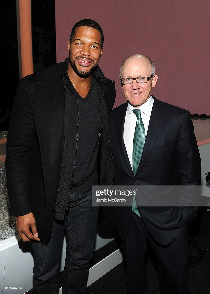 TV personality Michael Strahan (L) and NY Jets owner Woody Johnson attend the 2013 Victoria's Secret Fashion Show at Lexington Avenue Armory on November 13, 2013 in New York City.