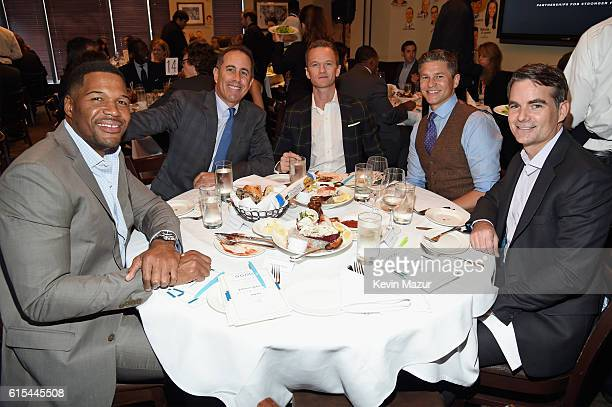 TV personality Michael Strahan Host Jerry Seinfeld Actor Neil Patrick Harris TV personality David Burtka and NASCAR Driver Jeff Gordon attend the New...