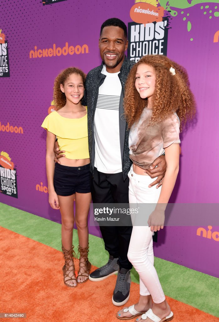 TV personality Michael Strahan (C) with Sophia Strahan (L) and Isabella Strahan (R) attend Nickelodeon Kids' Choice Sports Awards 2017 at Pauley Pavilion on July 13, 2017 in Los Angeles, California.
