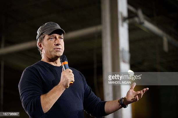 TV personality Mike Rowe host of 'Dirty Jobs' takes part in a roundtable discussion on manufacturing with Republican presidential candidate Mitt...
