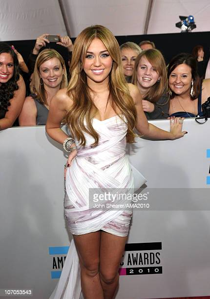 Personality Miley Cyrus arrives at the 2010 American Music Awards held at Nokia Theatre LA Live on November 21 2010 in Los Angeles California