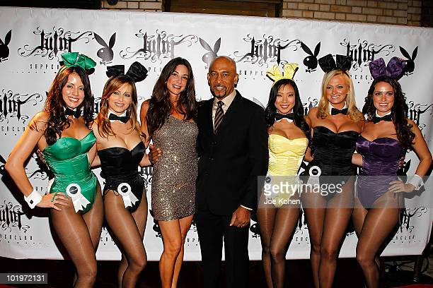TV personality Montel Williams and his wife Tara Williams pose for a photo with Playboy bunnies Pennelope Jimenez Deanna Brooks Hiromi Oshima Laurie...
