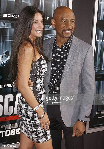 Personality Montel Williams Tara Fowler attend Escape Plan New York Premiere at Regal EWalk on October 15 2013 in New York City