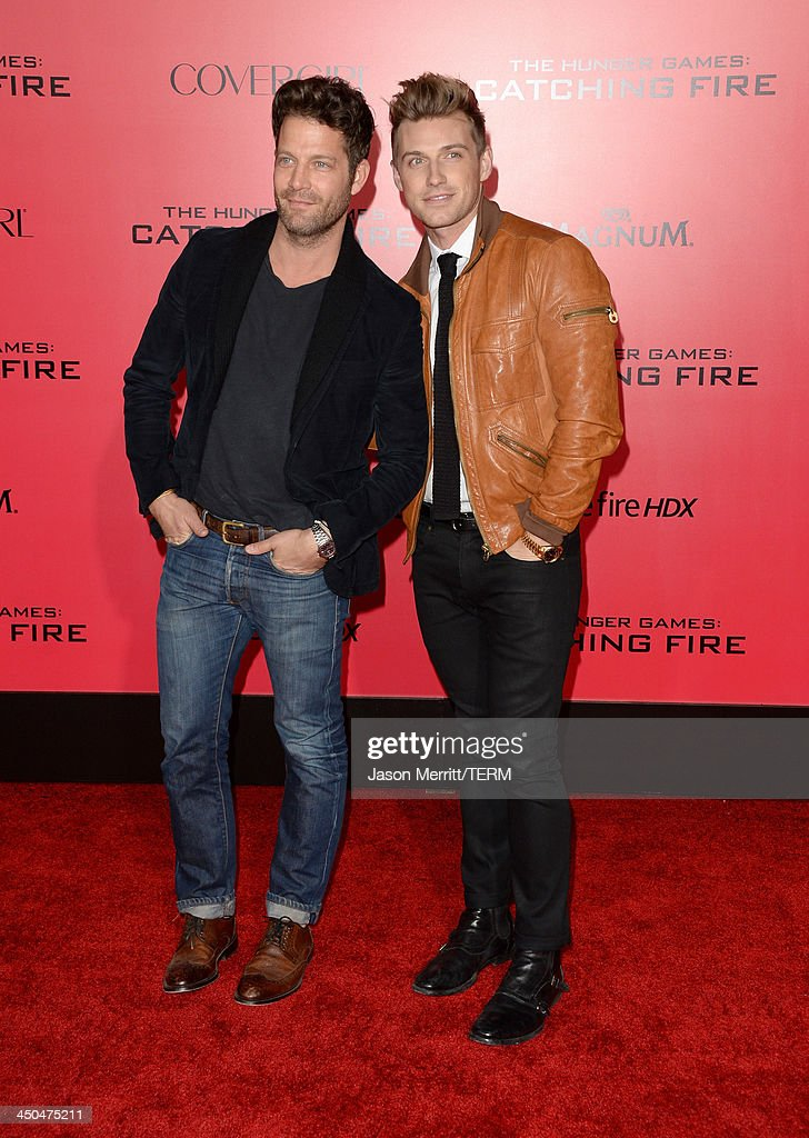 TV personality Nate Berkus (L) and guest arrive at the premiere of Lionsgate's 'The Hunger Games: Catching Fire' at Nokia Theatre L.A. Live on November 18, 2013 in Los Angeles, California.