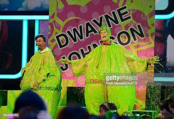 TV personality Nick Cannon and host Josh Duhamel perform during Nickelodeon's 26th Annual Kids' Choice Awards at USC Galen Center on March 23 2013 in...