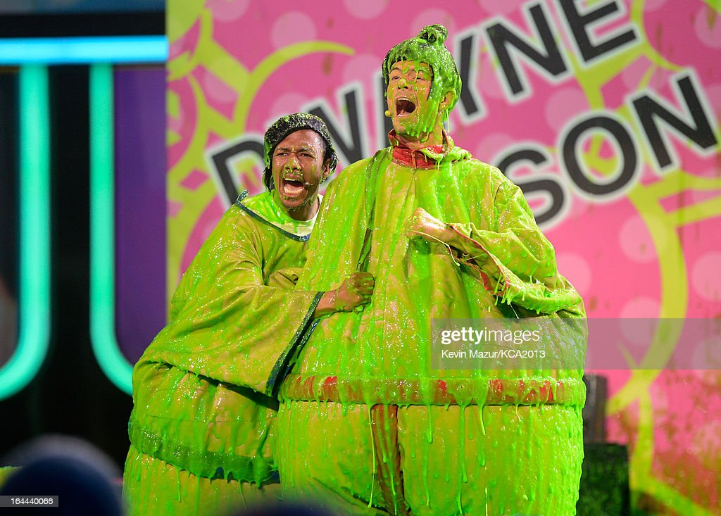 TV personality Nick Cannon (L) and host Josh Duhamel perform during Nickelodeon's 26th Annual Kids' Choice Awards at USC Galen Center on March 23, 2013 in Los Angeles, California.