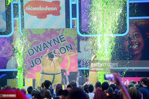 TV personality Nick Cannon and host Josh Duhamel perform onstage at Nickelodeon's 26th Annual Kids' Choice Awards at USC Galen Center on March 23...