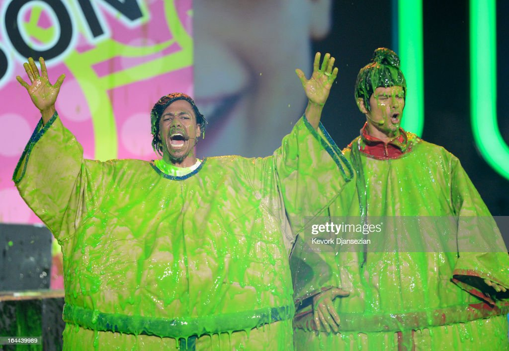 TV personality Nick Cannon (L) and host Josh Duhamel perform onstage during Nickelodeon's 26th Annual Kids' Choice Awards at USC Galen Center on March 23, 2013 in Los Angeles, California.