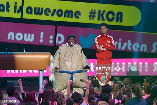 TV personality Nick Cannon and host Josh Duhamel perform onstage during Nickelodeon's 26th Annual Kids' Choice Awards at USC Galen Center on March 23...