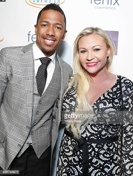 TV personality Nick Cannon and Nicole Paxson attend Get Lucky For Lupus LA on September 18 2014 in Beverly Hills California