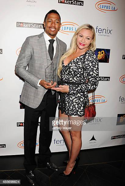 TV personality Nick Cannon and Nicole Paxson attend the Stars Get Lucky For Lupus 6th Annual Poker Tournament at Avalon on September 18 2014 in...