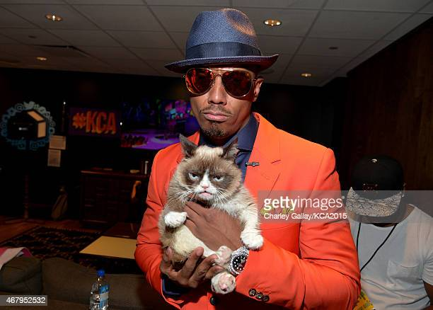TV personality Nick Cannon poses with Grumpy Cat backstage during Nickelodeon's 28th Annual Kids' Choice Awards held at The Forum on March 28 2015 in...