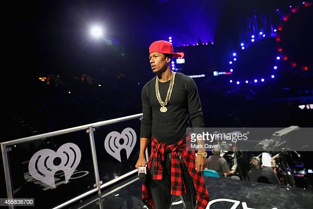 Personality Nick Cannon speaks onstage during the 2014 iHeartRadio Music Festival at the MGM Grand Garden Arena on September 20, 2014 in Las Vegas,...
