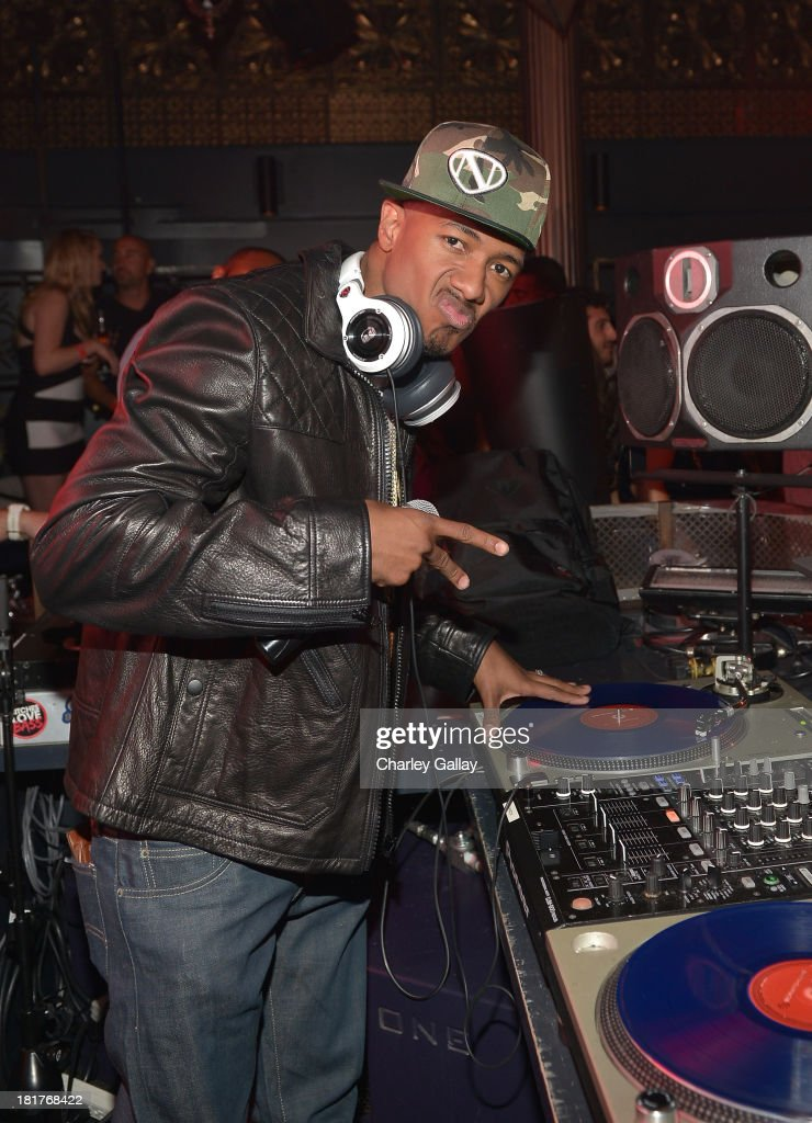 TV personality Nick Cannon spins onstage during the NBA 2K14 premiere party at Greystone Manor on September 24, 2013 in West Hollywood, California.
