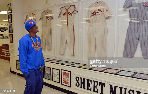 TV personality Nick Cannon tours the museum at the Bogart Pediatric Cancer Research Program's A Day Of Champions Children's Choice Award presented to...