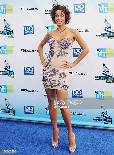 Personality Nicole Murphy arrives at the DoSomething.org And VH1's 2012 Do Something Awards at the Barker Hangar on August 19, 2012 in Santa Monica,...