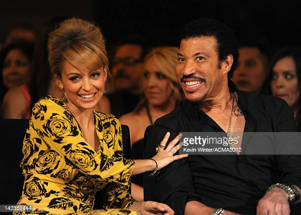 Personality Nicole Richie and singer Lionel Richie attend the Lionel Richie and Friends in Concert presented by ACM held at the MGM Grand Garden...