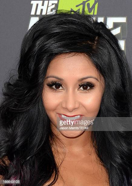 TV personality Nicole 'Snooki'' Polizzi arrives at the 2013 MTV Movie Awards at Sony Pictures Studios on April 14 2013 in Culver City California