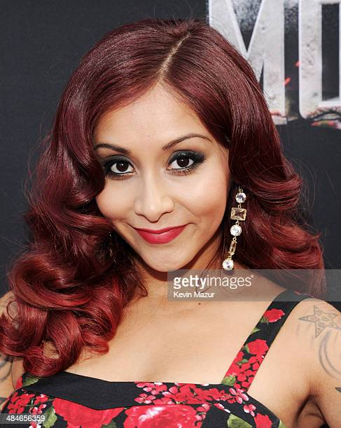 TV personality Nicole 'Snooki' Polizzi attends the 2014 MTV Movie Awards at Nokia Theatre LA Live on April 13 2014 in Los Angeles California