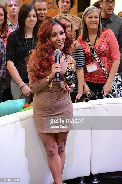V Personality Nicole 'Snooki' Polizzi films a commercial during the Nicole 'Snooki' Polizzi Meet Greet during the 2013 Smart Tan Downtown Convention...