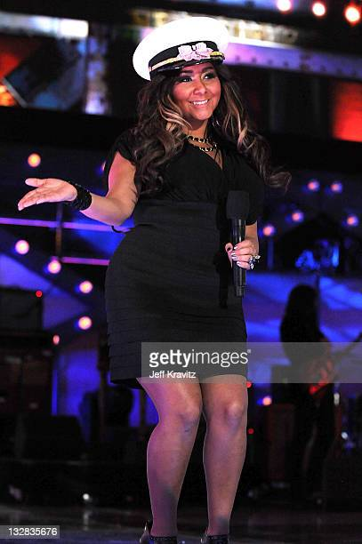 TV personality Nicole 'Snooki' Polizzi speaks onstage during 'VH1 Divas Salute the Troops' presented by the USO at the MCAS Miramar on December 3...