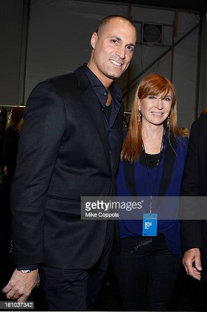 Personality Nigel Barker and designer Nicole Miller pose backstage at the Nicole Miller Fall 2013 fashion show during MercedesBenz Fashion Week at...