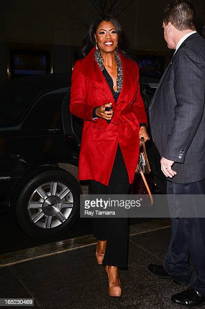 TV personality Omarosa Manigault enters the Late Night With Jimmy Fallon taping at the NBC Rockefeller Center Studios on April 1 2013 in New York City