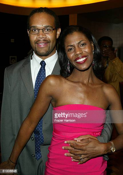 Personality Omarosa ManigaultStallworth and her husband Aaron Stallworth visit the Distinctive Asset Gift Lounge during the 2004 BET Music Awards at...