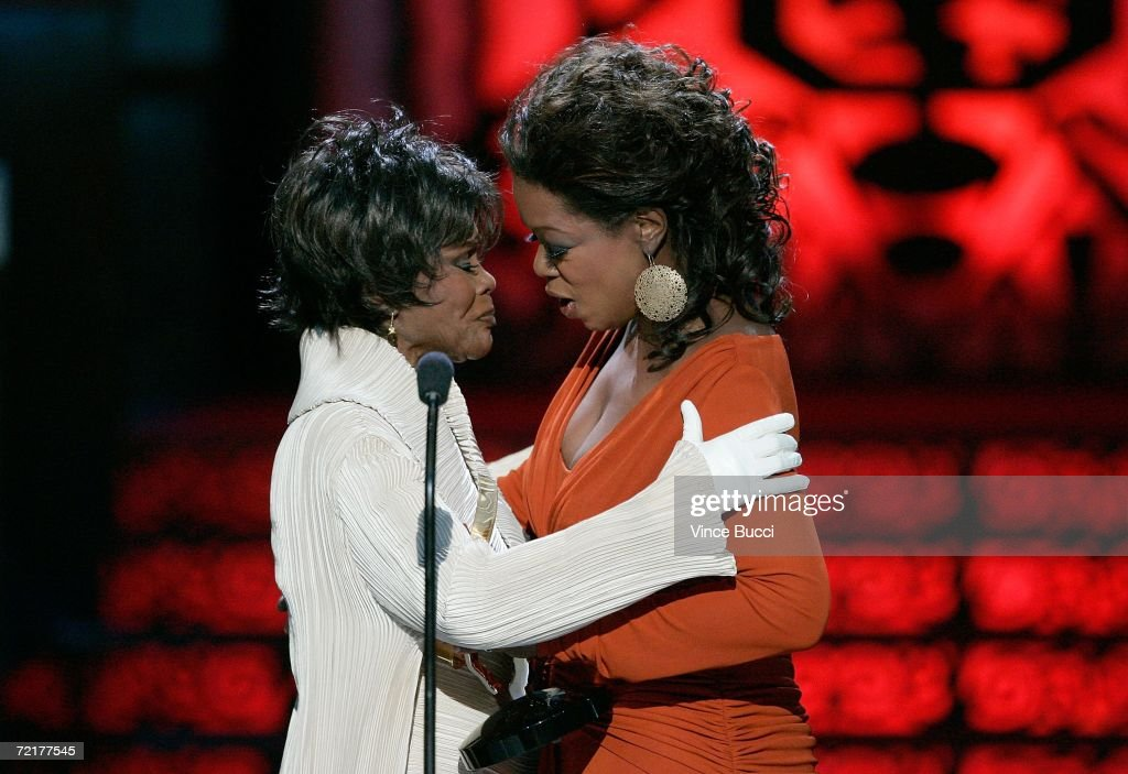 TV personality Oprah Winfrey (R) presents the BMA Hall of Fame Distinguished Career Achievement Award to Cicely Tyson onstage during the Film Life's 2006 Black Movie Awards at the Shrine Wiltern Theater on October 15, 2006 in Los Angeles, California.