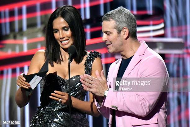 Personality Padma Lakshmi and TV personality-producer Andy Cohen speak onstage during the 2018 Billboard Music Awards at MGM Grand Garden Arena on...