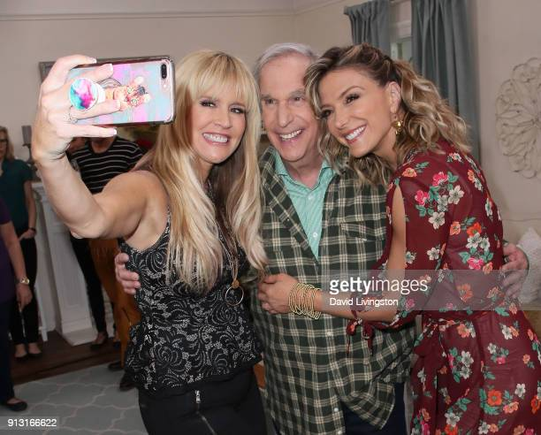 TV personality Paige Hemmis actor Henry Winkler and host Debbie Matenopoulos pose for a selfie at Hallmark's Home Family at Universal Studios...