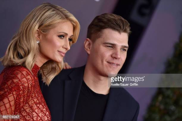 TV personality Paris Hilton and actor Chris Zylka attend the 2018 iHeartRadio Music Awards at the Forum on March 11 2018 in Inglewood California