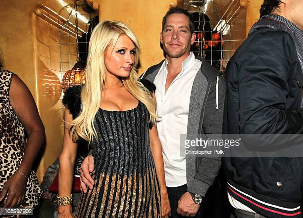 TV personality Paris Hilton and Cy Waits attend the RED launches with Usher after party on February 10 2011 in Hollywood California