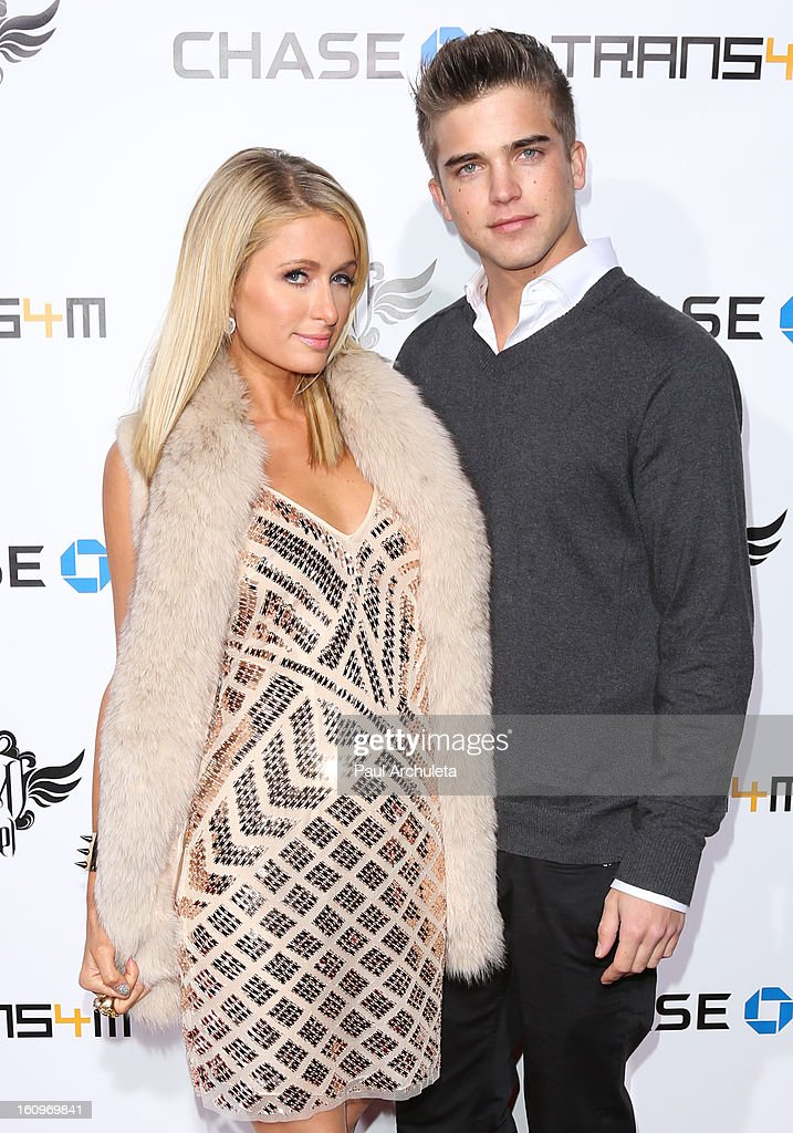 TV Personality Paris Hilton (L) and her Boyfriend Model River Viiperi (R) attend the 2nd Annual will.i.am TRANS4M Boyle Heights benefit concert at Avalon on February 7, 2013 in Hollywood, California.