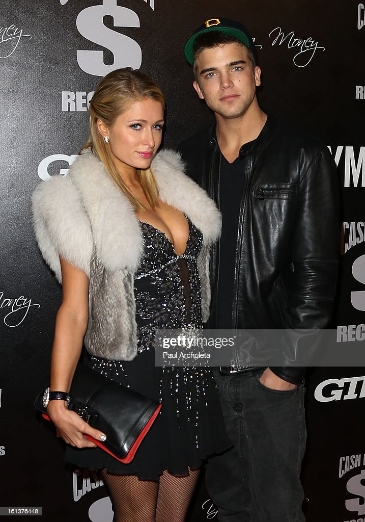 TV Personality Paris Hilton (L) and her boyfriend, model River Viiperi (R) attend the Cash Money Records 4th annual Pre-GRAMMY Awards party on February 9, 2013 in West Hollywood, California.