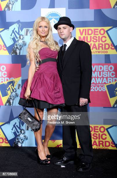 Personality Paris Hilton and musician Benji Madden pose in the press room at the 2008 MTV Video Music Awards at Paramount Pictures Studios on...
